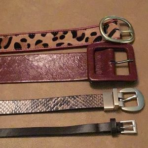 Four belts - one leather others synthetic leather.